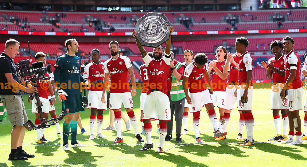 Alexandre Lacazette of Arsenal holds the trophy aloft during the FA Community Shield match between Arsenal and Chelsea at Wembley Stadium in London. 06 Aug 2017