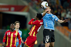 Anthony Annan of Ghana vs Diego Perez of Uruguay  during to the 2010 FIFA World Cup South Africa Quarter Finals football match between Uruguay and Ghana on July 02, 2010 at Soccer City Stadium in Sowetto, suburb of Johannesburg. (Photo by Vid Ponikvar / Sportida)