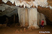 guide examines cave formations at Crystal Cave, on the grounds of Jaguar Paw Jungle Resort, Cayo District, Belize, Central America MR 335