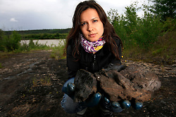 CANADA ALBERTA FORT MCMURRAY 19JUL09 - Greenpeace Canada campaigner Melina Laboucan-Massimo  holds a piece of bituminous rock at the Bitumount oil extraction site on the river Athabasca north of Fort McMurray, northern Alberta, Canada...jre/Photo by Jiri Rezac / GREENPEACE..© Jiri Rezac 2009