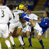 St Johnstone v Dunfermline..CIS Cup..28.10.03<br />Craig Brewster and Darren Young battle with Mark Robertson <br /><br />Picture by Graeme Hart.<br />Copyright Perthshire Picture Agency<br />Tel: 01738 623350  Mobile: 07990 594431