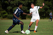 Burlington's Maenda Bienfait Badibang (21) runs past Rice's Brent McKeown (2) with the ball during the boys soccer game between the The Burlington Seahorses and the Rice Green Knights at Rice Memorial high School on Tuesday afternoon September 15, 2015 in South Burlington, Vermont. (BRIAN JENKINS/for the FREE PRESS)