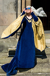 Pictured: The sun only shines on the rightious; Actress Katie Milne, dressed as St Margaret.<br /> <br /> Today Archbishop Leo Cushley was joined by 'St Margaret of Scotland' to unveil the publicity poster being sent to every Catholic parish in the country to advertise this summer's St Margaret's Pilgrimage, which will take place on 12 June in Dunfermline. Actress Katie Milne, dressed as St Margaret, joined the Archbishop in Edinburgh to launch the poster.<br /> <br /> Ger Harley | EEm 10 May April 2016