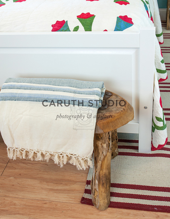 Vintage style bedroom: Rustic wooden bench and throw