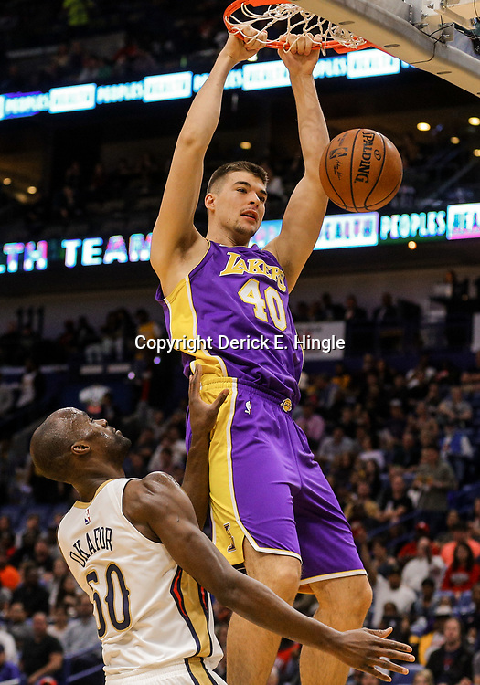 Mar 22, 2018; New Orleans, LA, USA; Los Angeles Lakers center Ivica Zubac (40) dunks over New Orleans Pelicans center Emeka Okafor (50) during the first quarter at the Smoothie King Center. Mandatory Credit: Derick E. Hingle-USA TODAY Sports