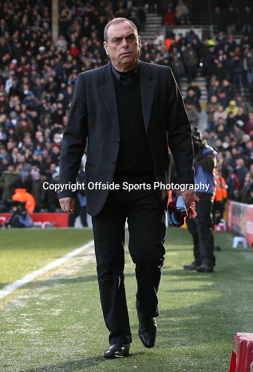 26/12/2010 - Barclays Premier League - Fulham vs. West Ham United - West Ham manager Avram Grant carries his scarf - Photo: Simon Stacpoole / Offside.