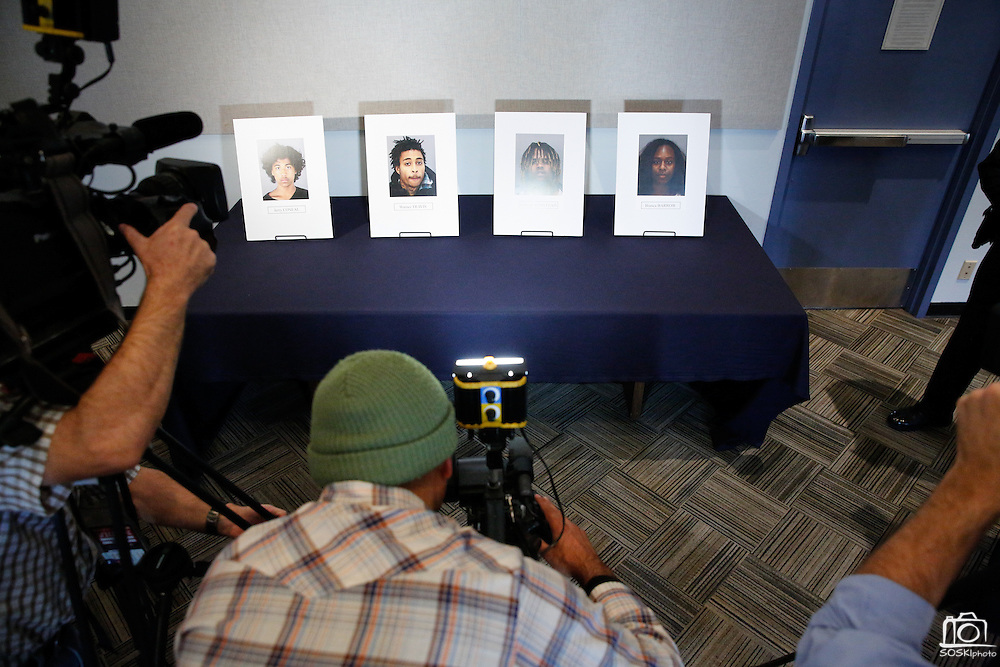 Members of the media surround photographs of suspects arrested for the murder of Mohammad Reza Sadeghzadeh, a 67-year-old Milpitas 7-Eleven night clerk who was murdered on September 8, 2012 during a 2:13 a.m. robbery, during a press conference at the Milpitas Police Department in Milpitas, California, on December 12, 2013. (Stan Olszewski/SOSKIphoto)