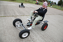 Woman with learning disability riding go-cart on visit to farm