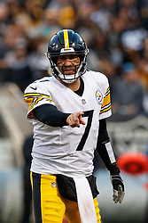 OAKLAND, CA - DECEMBER 09: Quarterback Ben Roethlisberger #7 of the Pittsburgh Steelers signals behind the line of scrimmage during the fourth quarter against the Oakland Raiders at the Oakland Coliseum on December 9, 2018 in Oakland, California. The Oakland Raiders defeated the Pittsburgh Steelers 24-21. (Photo by Jason O. Watson/Getty Images) *** Local Caption *** Ben Roethlisberger
