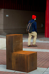 © Licensed to London News Pictures. 13/12/2011 London, UK. .The Antony Gormley sculpture, 'Witness' outside The British Library, London. The piece was commissioned by English PEN to mark it's 90th anniversary and is cast in iron depicting an empty chair to represent writers around the world..Photo credit : Simon Jacobs/LNP
