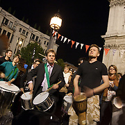 Samba band in the square by night. The London Stock Exchange was attempted occypied in solidarity with Occupy Wall in Street in New York and in protest againts the economic climate, blamed by many on the banks. Police managed to keep people away fro the Patornoster Sqaure and the Stcok Exchange and thousands of protestors stayid in St. Paul's Square, outside St Paul's Cathedral. Many camped getting ready to spend the night in the square.