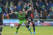 Forest Green Rovers Ebou Adams(14) holds off Plymouth Argyle's Joel Grant(16) during the EFL Sky Bet League 2 match between Forest Green Rovers and Plymouth Argyle at the New Lawn, Forest Green, United Kingdom on 16 November 2019.