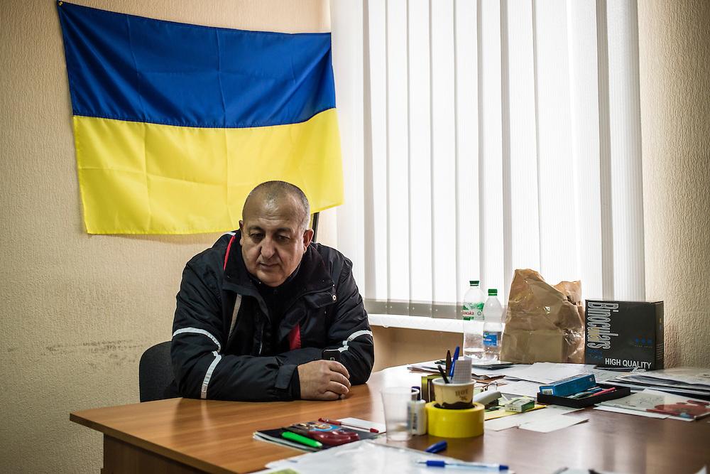 Vitaliy Beltadze, Chief of Staff of the Berdyansk self-defense force, sits in his office on Wednesday, October 15, 2014 in Berdyansk, Ukraine. Photo by Brendan Hoffman, Freelance