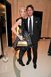 TAMARA BECKWITH and her husband GIORGIO VERONI at a dinner in honour of Dennis Basso in celebration of his new boutique in Harrods held at Claridge's, Brook Street, London on 15th October 2009.