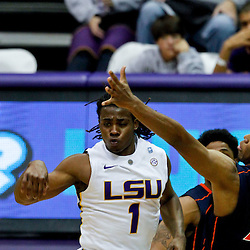 January 2, 2012; Baton Rouge, LA; LSU Tigers guard Anthony Hickey (1) passes as Virginia Cavaliers forward Akil Mitchell (25) defends during the second half of a game at the Pete Maravich Assembly Center. Virginia defeated LSU 57-52.  Mandatory Credit: Derick E. Hingle-US PRESSWIRE