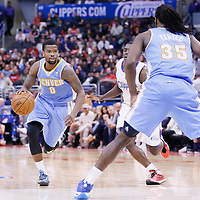 15 April 2014: Denver Nuggets guard Aaron Brooks (0) drives past Los Angeles Clippers guard Darren Collison (2) during the Los Angeles Clippers 117-105 victory over the Denver Nuggets at the Staples Center, Los Angeles, California, USA.