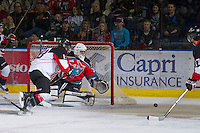 KELOWNA, CANADA - DECEMBER 8:  Jordon Cooke #30 of the Kelowna Rockets defends the net against the Prince George Cougars at the Kelowna Rockets on December 8, 2012 at Prospera Place in Kelowna, British Columbia, Canada (Photo by Marissa Baecker/Shoot the Breeze) *** Local Caption ***