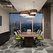 Office interior conference room with sunset skyline.