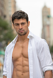 hot man with open shirt in city