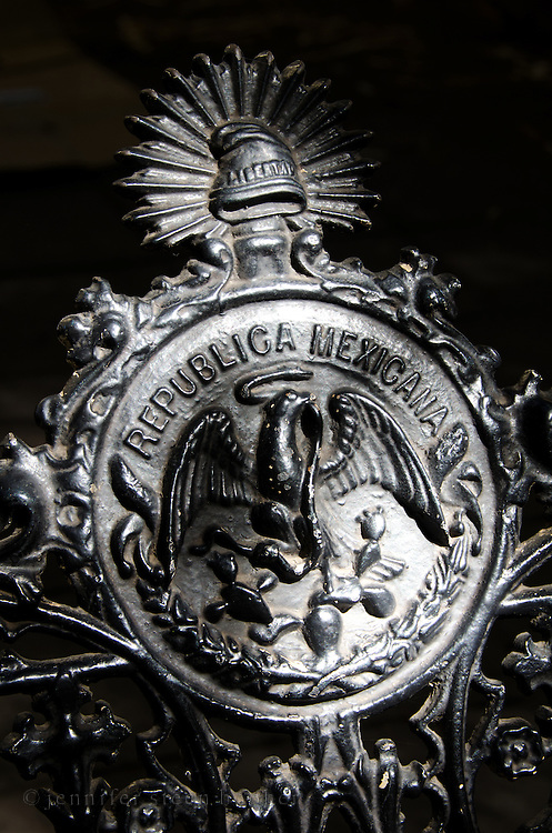 Cast iron bench in the Zocalo, Oaxaca, showing the old Republica Mexicana seal.