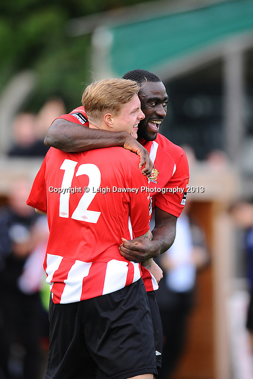 George Purcell of AFC Hornchurch (12) celebrates his goal with fellow team mate Tambeson Eyong. AFC Hornchurch v Wealdstone at The Stadium, Bridge Avenue, Upminster, Essex. FA Cup 3rd Qualifying Round. 12th October 2013. © Leigh Dawney Photography 2013.