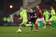 Brighton striker (on loan from Manchester United), James Wilson (21) breaks with pace and goes past Nottingham Forest midfielder Gary Gardner (22) during the Sky Bet Championship match between Nottingham Forest and Brighton and Hove Albion at the City Ground, Nottingham, England on 11 April 2016.
