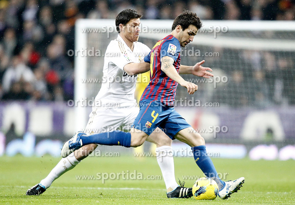 10.12.2011, Santiago Bernabeu Stadion, Madrid, ESP, Primera Division, Real Madrid vs FC Barcelona, 15. Spieltag, im Bild Real Madrid's Xabi Alonso against Barcelona's Cesc Fabregas // during the football match of spanish 'primera divison' league, 15th round, between Real Madrid and FC Barcelona at Santiago Bernabeu stadium, Madrid, Spain on 2011/12/10. EXPA Pictures © 2011, PhotoCredit: EXPA/ Alterphotos/ Alvaro Hernandez..***** ATTENTION - OUT OF ESP and SUI *****