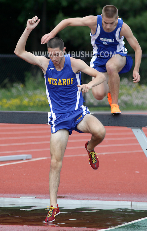 Washingtonville's Vinny DeSalvo, left, and Monticello's Dave Wilbur finished first and second in the boys' 3,000-meter steeplechase at the Section 9 state qualifier in Middletown on Friday, June 4, 2010. Both qualified for the state meet.