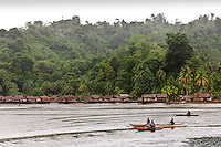 Dugout canoes in front of a traditional water village, Yapen, West Papua, Indonesia.