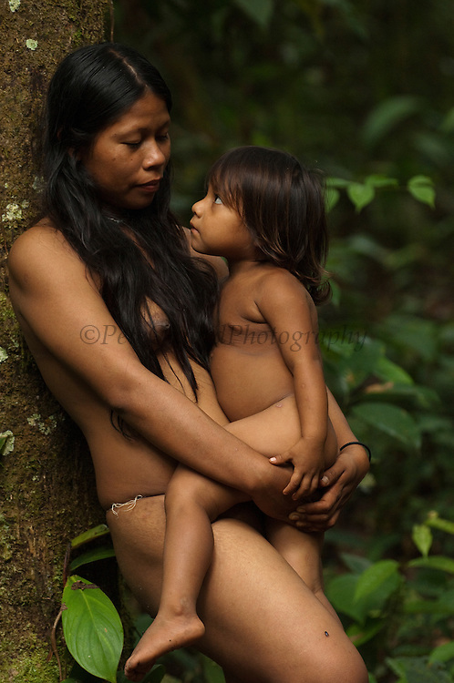 Huaorani Indian women &amp; child - Norma &amp; Romelia Kaiga. Gabaro Community. Yasuni National Park.<br /> Amazon rainforest, ECUADOR.  South America<br /> This Indian tribe were basically uncontacted until 1956 when missionaries from the Summer Institute of Linguistics made contact with them. However there are still some groups from the tribe that remain uncontacted.  They are known as the Tagaeri &amp; Taromanani. Traditionally these Indians were very hostile and killed many people who tried to enter into their territory. Their territory is in the Yasuni National Park which is now also being exploited for oil.