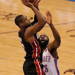 Jun 14, 2012; Oklahoma City, OK, USA;  Miami Heat shooting guard Dwyane Wade (3) shoots against Oklahoma City Thunder guard James Harden (13) during the second quarter of game two in the 2012 NBA Finals at Chesapeake Energy Arena. Mandatory Credit: Derick E. Hingle-US PRESSWIRE
