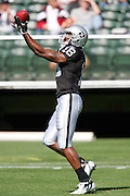 OAKLAND, CA - AUGUST 20:  Wide receiver Randy Moss #18 of the Oakland Raiders catches a pass during pre-game warmups against the San Francisco 49ers at McAfee Coliseum on August 20, 2006 in Oakland, California. The Raiders defeated the Niners 23-7. ©Paul Anthony Spinelli *** Local Caption *** Randy Moss