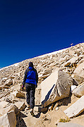Hiker and helicopter near the summit of Mount Whitney, Sequoia National Park,  California USA