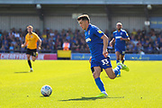 AFC Wimbledon midfielder Callum Reilly (33) dribbling during the EFL Sky Bet League 1 match between AFC Wimbledon and Bristol Rovers at the Cherry Red Records Stadium, Kingston, England on 21 September 2019.