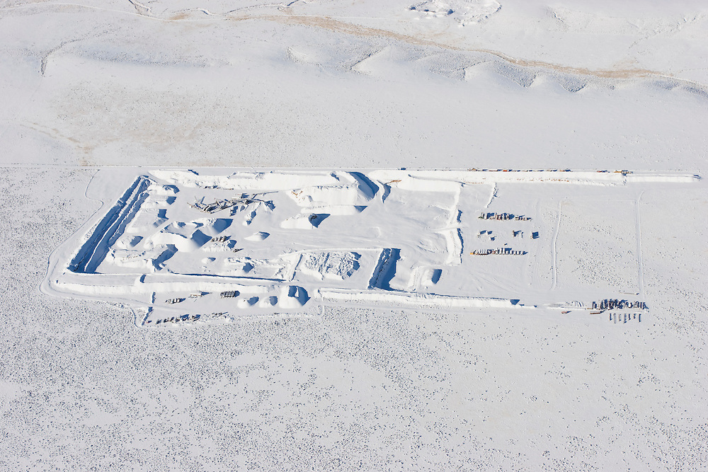 Aerial view of gravel pit covered in snow.