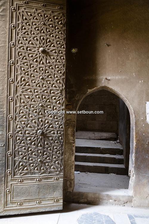 Egypt. Cairo -Khanqah of Sultan Baybars al Gashankir and minaret, restoration work by Historic Cairo,  in al Gamaliyyah  area.  Islamic Cairo . restorastion works . street life ,   Cairo -  NM32 +
