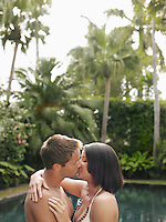 Young Couple Kissing in Garden