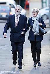 Dave Lee Travis arrives at court this morning alongside his wife. Southwark Crown Court, London, United Kingdom. Thursday, 13th February 2014. Picture by i-Images