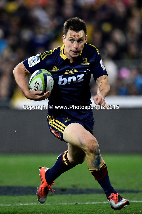 Ben Smith of the Highlanders runs the ball during the Super Rugby final rugby match between the Hurricanes and Highlanders at the Westpac Stadium in Wellington on Saturday the 4th of July 2015. Copyright photo by Marty Melville / www.Photosport.nz
