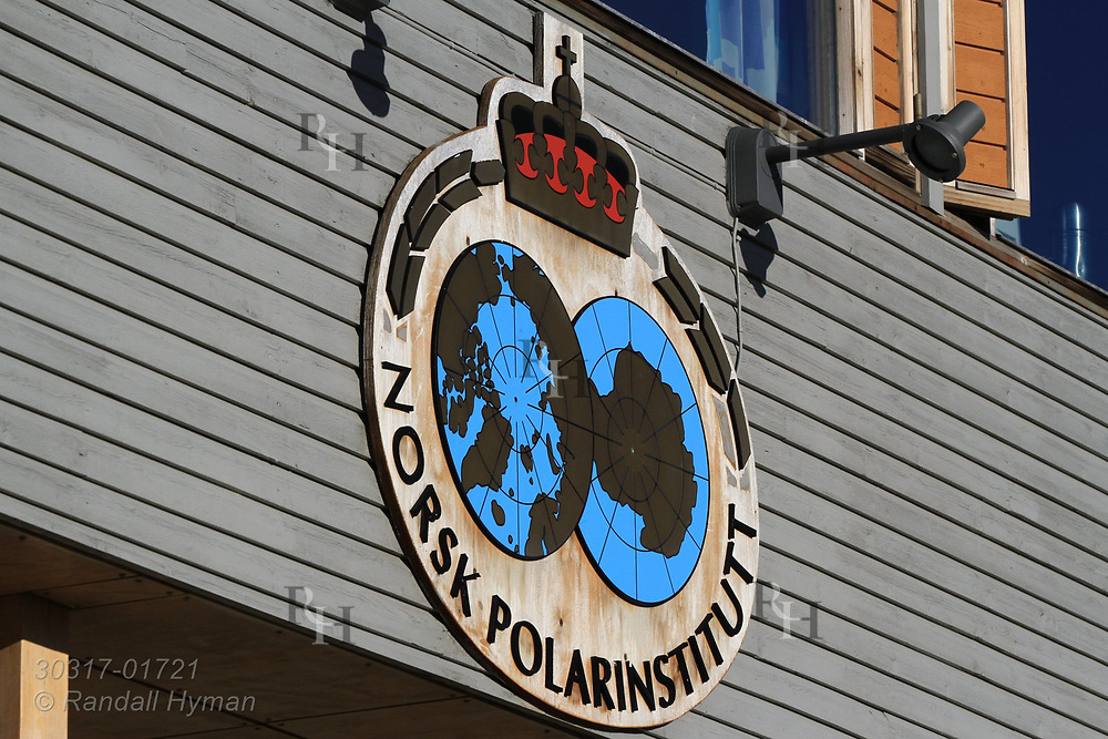 Norwegian Polar Institute emblem adorns the largest research station at the international science village of Ny-Alesund; Spitsbergen, Svalbard, Norway.