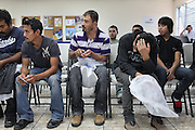 Guatemalan deportees listen to final instructions at the Migration Office in Guatemala City's La Aurora Airport after having been deported from the United States. Each week, fourteen flights arrive at La Aurora Airport from the U.S. carrying 135 deportees per airplane. Mostly men, the would-be migrants spend an average of two months at U.S. detention centers before they are sent back. From January 1st to May 17th, 2013, there have been 18,073 people deported back to Guatemala. Guatemala City, Guatemala. May 17, 2013.