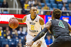 Nov 20, 2015; Morgantown, WV, USA; West Virginia Mountaineers guard Jevon Carter looks to pass while being defended by Stetson Hatters guard Divine Myles during the first half at WVU Coliseum. Mandatory Credit: Ben Queen-USA TODAY Sports