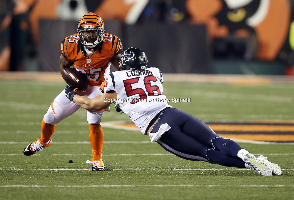 Cincinnati Bengals running back Giovani Bernard (25) catches a pass and runs with the ball while trying to elude a tackle attempt by diving Houston Texans inside linebacker Brian Cushing (56) with less than one minute left in the fourth quarter during the 2015 week 10 regular season NFL football game against the Houston Texans on Monday, Nov. 16, 2015 in Cincinnati. The Texans won the game 10-6. (©Paul Anthony Spinelli)