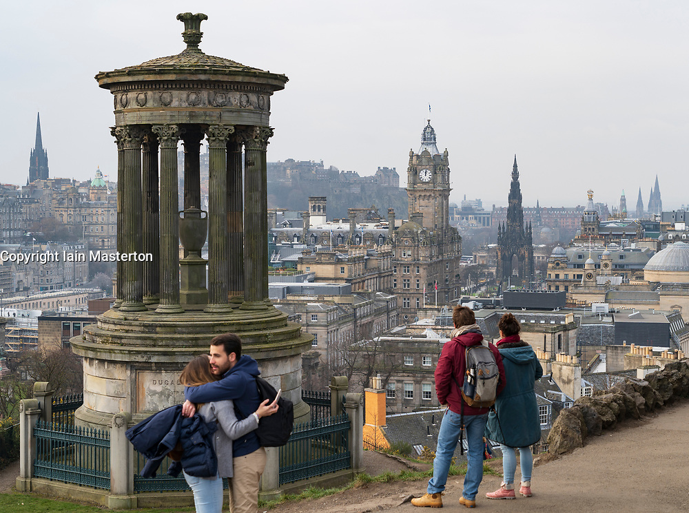 Tourists enjoying view of city of Edinburgh from Calton Hill viewpoint, Scotland, UK