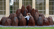 © Licensed to London News Pictures. 07/06/2012. Kew, UK Finn Britten aged 4 and a half years from Richmond Surrey, plays on 'Iron Dome' constructed in 201 from Cast Iron. The Royal Botanic Gardens, Kew, hosts a photocall for an exhibition of sculpture by David Nash in the grounds and Temperate Houses. The exhibition opens to the public on 9th June 2012 and finishes on 14th April 2013  Photo credit : Stephen Simpson/LNP