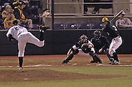 Kansas State's Brad Hutt (20) fires in a pitch to Wichita State's Derek Schermerhorn (R) in the top of the fifth inning.  K-State defeated the 19th ranked Shockers 6-3 at Tointon Stadium in Manhattan, Kansas, March 14, 2006.