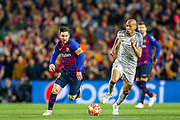 Barcelona forward Lionel Messi (10) goes past Liverpool midfielder Fabinho (3) during the Champions League semi-final leg 1 of 2 match between Barcelona and Liverpool at Camp Nou, Barcelona, Spain on 1 May 2019.