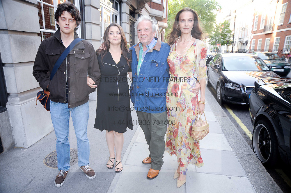 DAVID BAILEY his wife CATHERINE and children FENTON BAILEY and PALOMA BAILEY at a private view of photographs by David Bailey entitled 'Then' held at Hamiltons, 13 Carlos Place, London W1 on 6th July 2010.