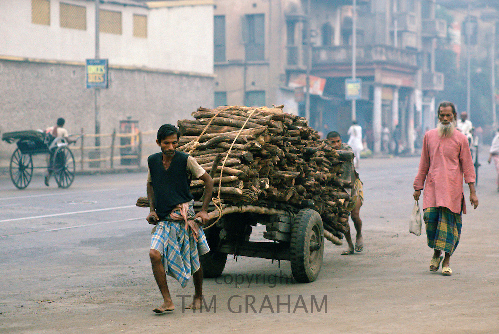 Man transporting wood, Calcutta , India