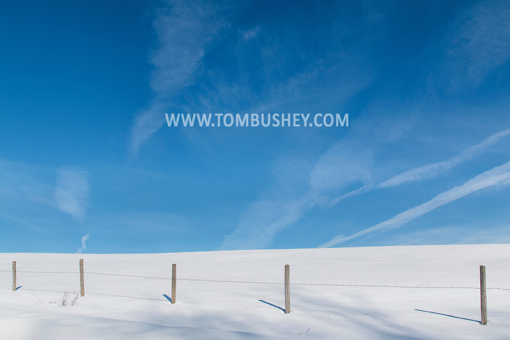 Cornwall, New York - A fence, a field and the sky on the morning of Feb. 24, 2015.